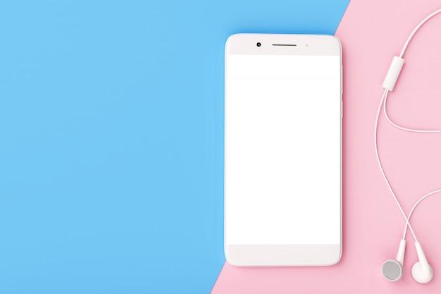 Smartphone met oortelefoon op pastel kleuren achtergrond.