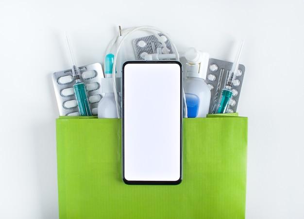 Smartphone op een zak met pillen
