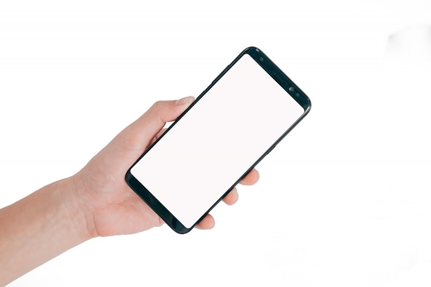 Smartphone-spot omhoog, hand die lege witte het scherm mobiele die telefoon houden op witte achtergrond wordt geïsoleerd