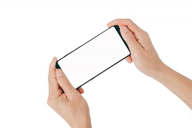 Smartphone-spot omhoog, hand die mobiele telefoon houden en het gebruiken van het scherm op witte achtergrond wordt geïsoleerd
