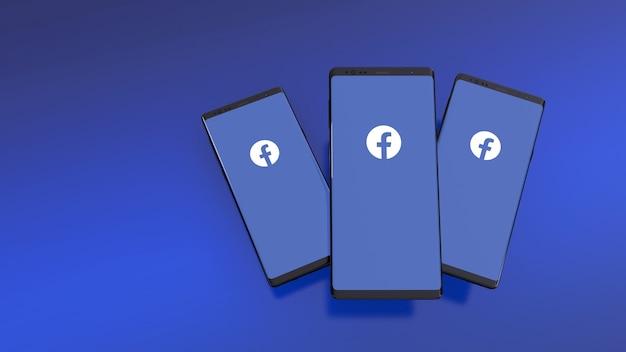 Smartphones met facebook-logo op scherm over blauw