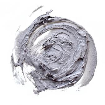 Smear clay mask voor gezicht geïsoleerd op een witte achtergrond