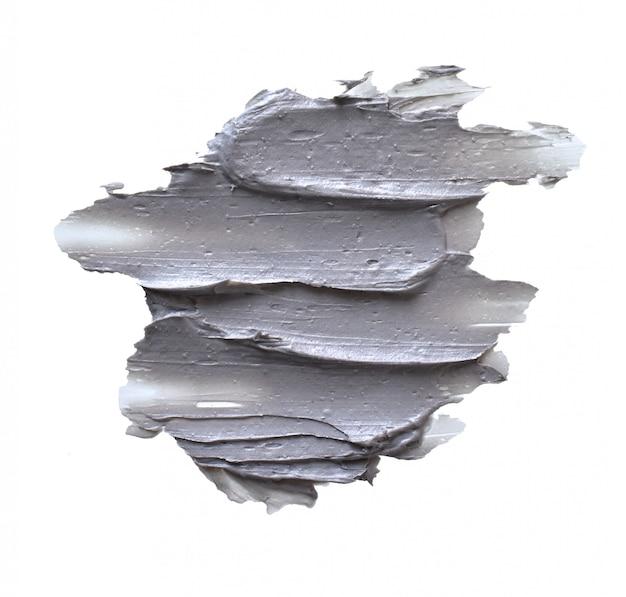 Smeer marine mud clay mask op een witte ondergrond Premium Foto
