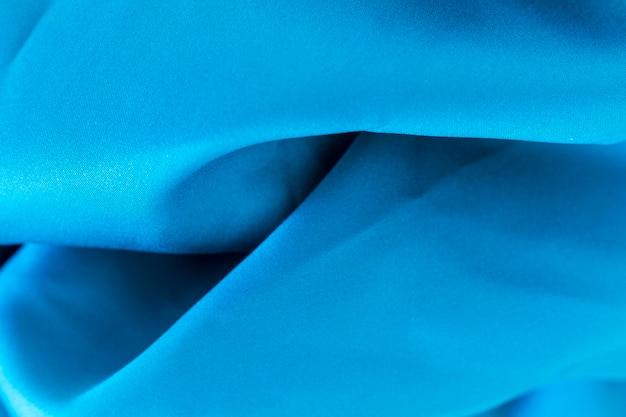 Soepele elegante blauwe stof materiële textuur