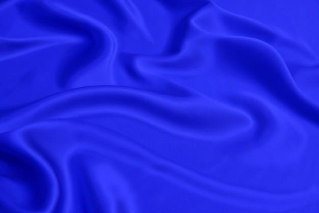 Soepele elegante blauwe zijde (satijn) stof als achtergrond voor ontwerp