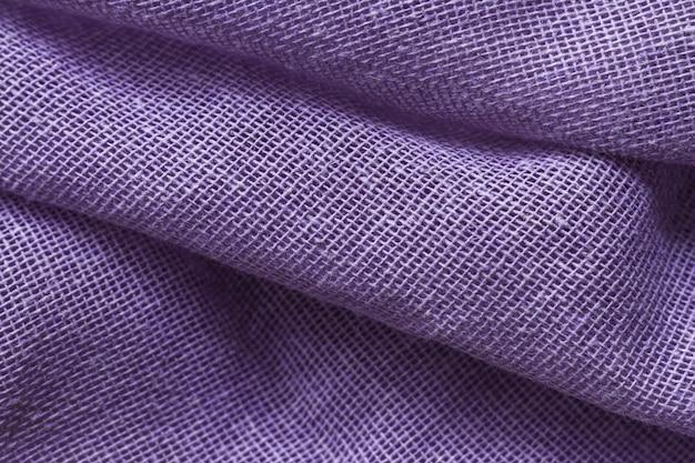 Soepele elegante paarse stof materiële textuur