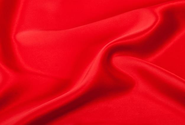 Soepele elegante rode zijden textuur details