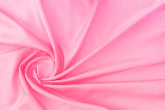 Soepele elegante roze zijde of satijn textuur