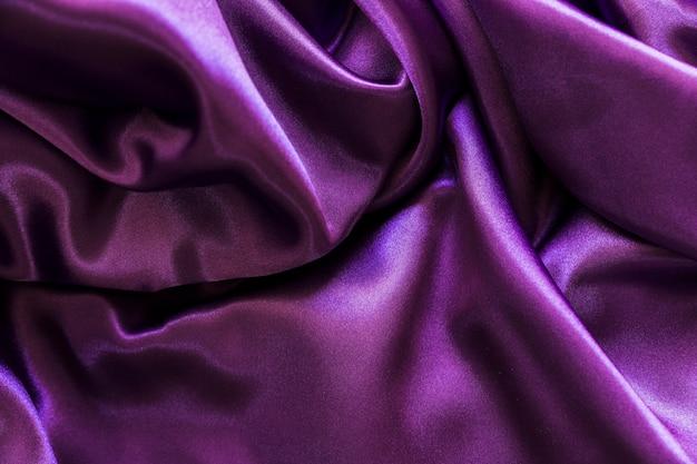 Soepele lila zijde textiel achtergrond