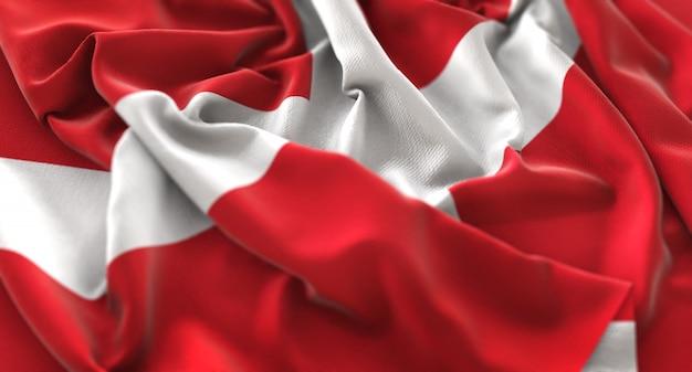 Soevereine militaire orde van malta vlag ruffled mooi wegende macro close-up shot