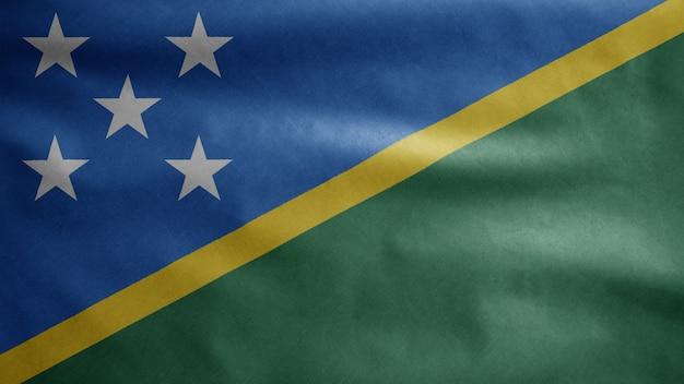 Solomon islander vlag zwaaien in de wind. close-up solomon islander banner waait, zachte en gladde zijde. doek stof textuur vlag achtergrond. gebruik het voor het concept van nationale dag en landgelegenheden.