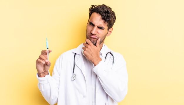 Spaanse knappe man denkt, voelt zich twijfelachtig en verward arts en srynge-concept