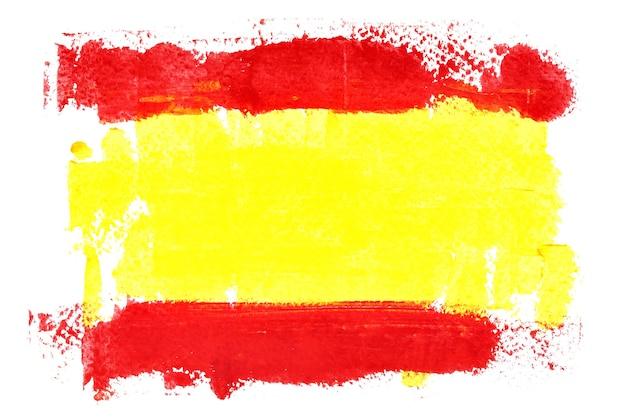 Spaanse vlag door penseelstreken geïsoleerd op de witte achtergrond