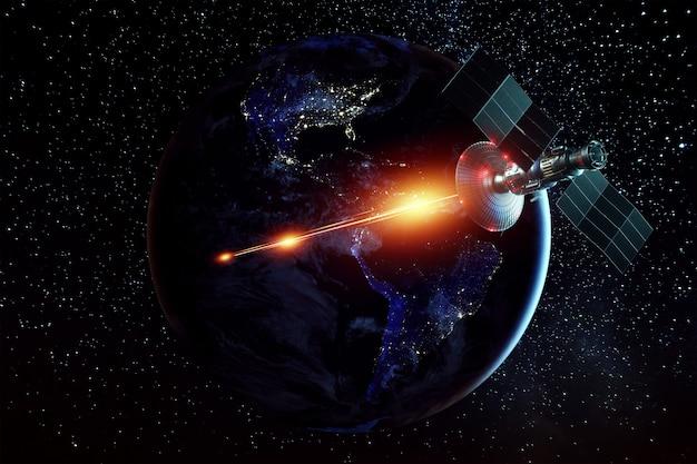 Space militaire satelliet, een wapen in de ruimte schiet een laser tegen de muur van de aarde. aanval, technologie, ruimteoorlog. gemengd medium, kopieer ruimte. afbeelding geleverd door nasa.