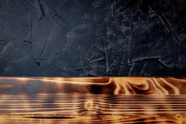 Spatie voor tekst - zwarte en houten achtergrond. hoge kwaliteit foto
