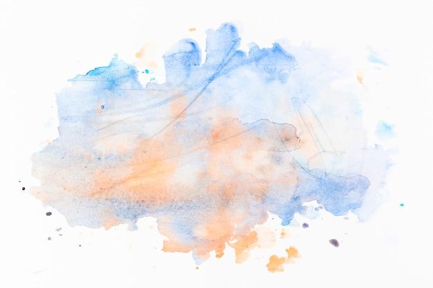 Spatten van lichtblauwe en oranje verf