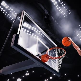 Speler gooit de bal in de basket