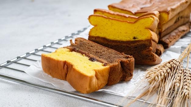 Spiku of lapis surabaya, de layers rich egg yolk cake met strawberry jam ertussen, bright mood photoshoot