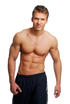 Sport en gezondheid lichaam van jonge man. geïsoleerd op wit.