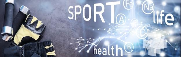 Sporten en een gezonde levensstijl. accessoires voor sport. yogamat halter en springtouw. sportachtergrond met het concept van huisoefeningen.