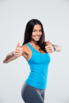 Sportieve vrouw duim omhoog teken tonen
