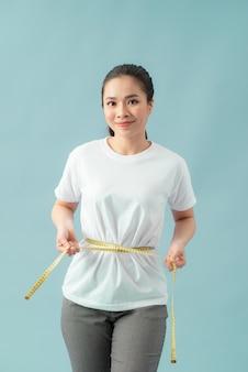 Sportkleding slank figuur centimeter mooie vrouwentape