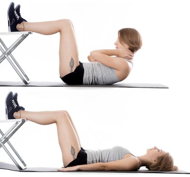 Sportvrouw doen sit-ups