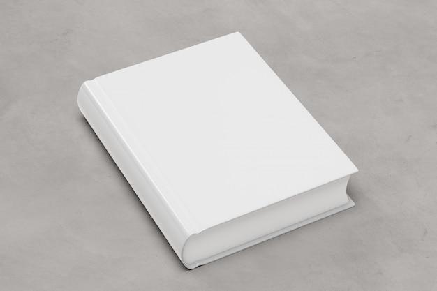 Spot omhoog van een boek over een concrete achtergrond - het 3d teruggeven