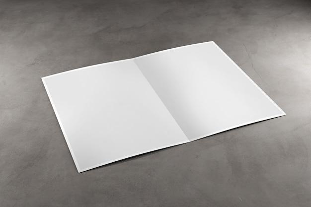 Spot omhoog van een brochure op een concrete achtergrond - het 3d teruggeven