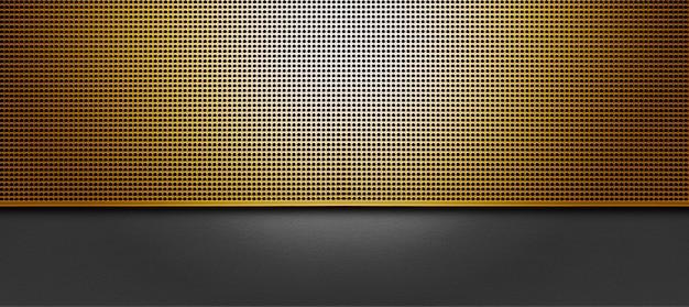 Spot verlichte geperforeerde gplden metalen plaat. metalen achtergrond close-up
