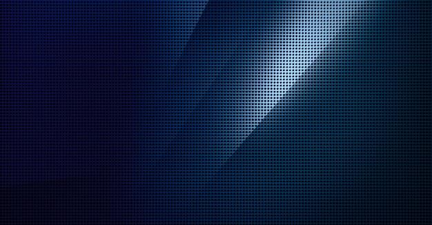 Spot verlichte geperforeerde metalen plaat. metalen achtergrond close-up