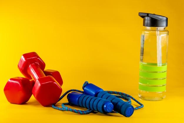 Springtouw, halters en een fles water