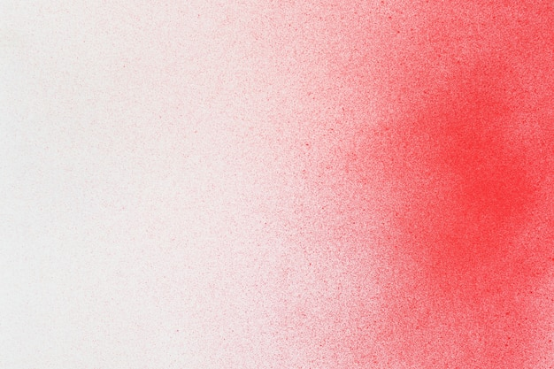Spuitverf rood op een achtergrond van wit papier