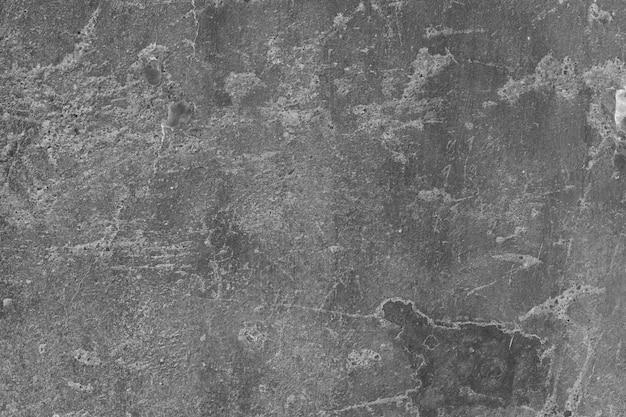 Stained grijze gepleisterde muur