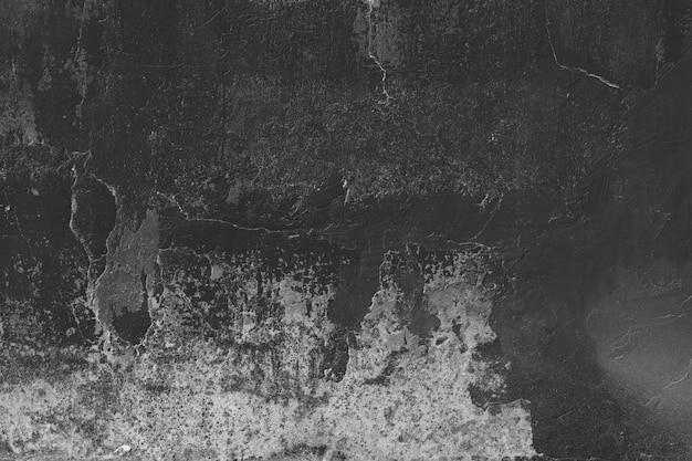 Stained zwart en grijs gepleisterde muur