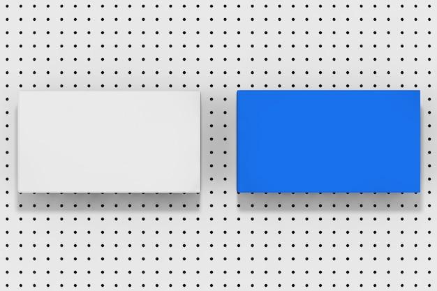 Stapel blauwe en witte lege mockup vellen op een witte kleine polka dot achtergrond extreme close-up. 3d-rendering