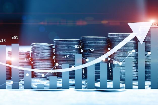 Stapel geldmuntstuk met handelsgrafiek voor financiële investeerder