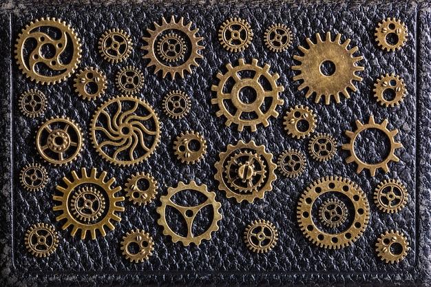 Steampunk mechanische tandwielen op lederen oppervlak