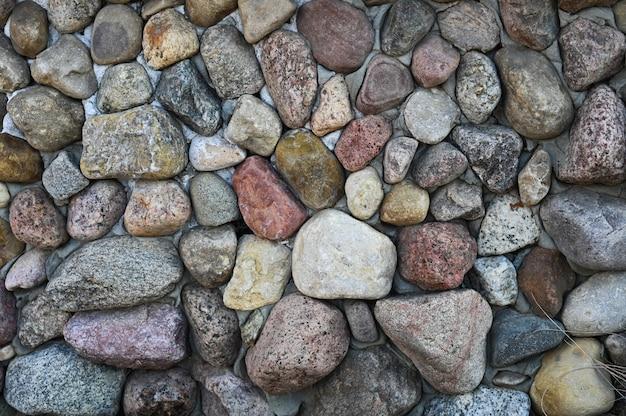 Steen straatstenen close-up. achtergrond van verschillende stenen