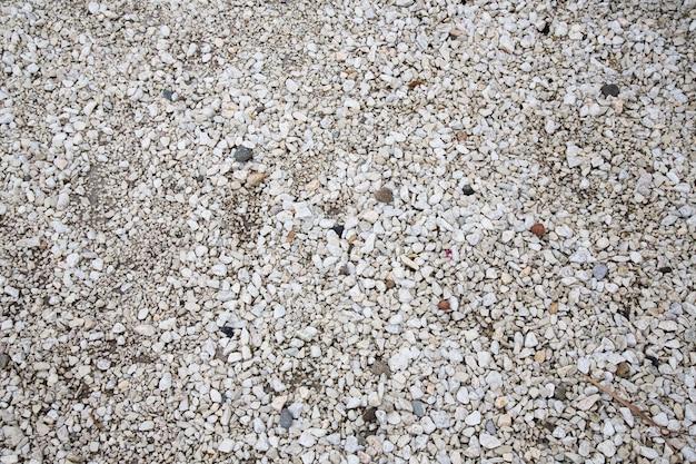 Steen textuur. achtergrondtextuur van kleine witte stenen op het strand
