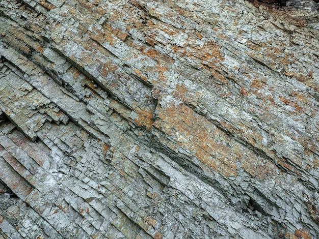 Steen textuur. dwarsdoorsnede van rotsen. geologische lagen. gekleurde lagen stenen in sectie van de berg, verschillende rotsformaties en bodemlagen.