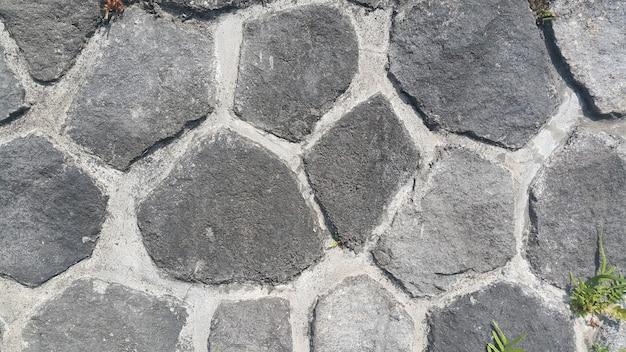 Steenkoolbasalt graniet rots natuur muur textuur achtergrond donkergrijze zwarte kleur