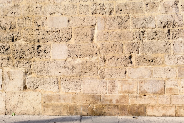 Steenmuur, achtergrond van loeiende muur.