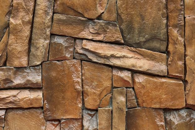 Steenmuur, bruine rotstextuur in natuurlijk patroon