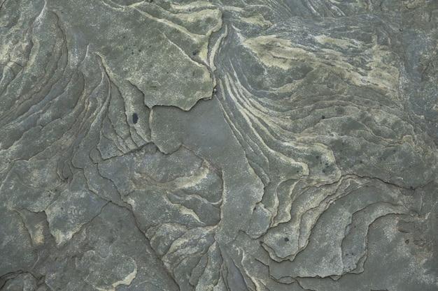 Steenoppervlakte, de natuurlijke beige achtergrond van de textuursteen