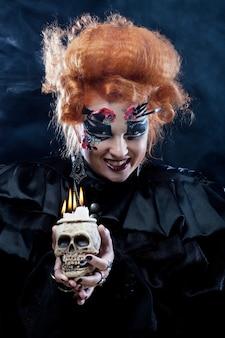 Stel je een mooie fantasievrouw met schedel voor. halloween-thema. feestthema.