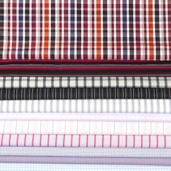 Stel verschillende textuur katoen gekleurde stof. achtergrond abstractie van textiel in de fabriek