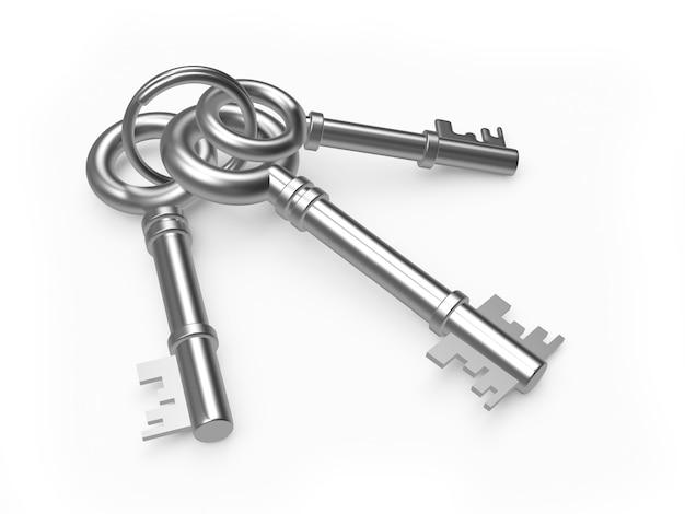 Stelletje drie oude zilveren of metalen sleutels