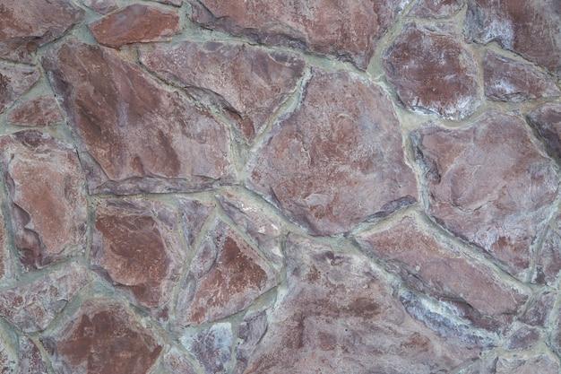 Stenen achtergrond van bruin natuursteen. steen textuur.