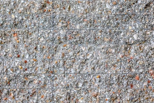 Stenen bakstenen stok in de muur